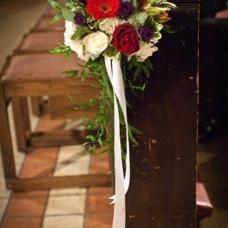 Flowers decorating church pews